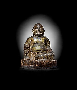 548. A large seated bronze figure of Budai, Ming Dynasty, dated to the fifth year of Jiajing (1526).