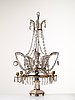 A presumably russian louis xvi gilt brass and cut glass four-light table girandole.