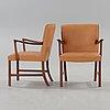 A pair of ole wanscher palisander armchairs, denmark 1960's.