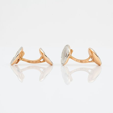 A pair of mother of pearl and diamond cufflinks.