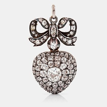 1124. HÄNGE/MEDALJONG, hjärtformat med gammalslipade diamanter, öppningsbart. Mittsten ca 1.00 ct. 1800-talets andra hälft.