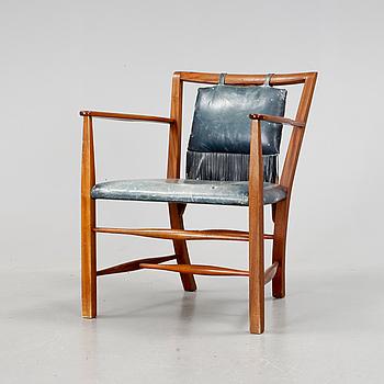 A Josef Frank mahogany armchair upholstered in dark blue leather, Svenskt Tenn,