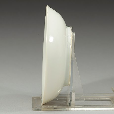 A white-glazed moulded small dish, qing dynasty, 18th century.