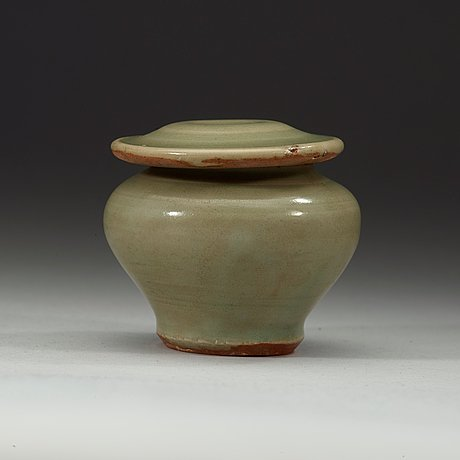A celadon miniature jar with cover, ming dynasty (1368-1644).
