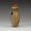 A carved chalcedony snuff bottle, qing dynasty, 19th century.