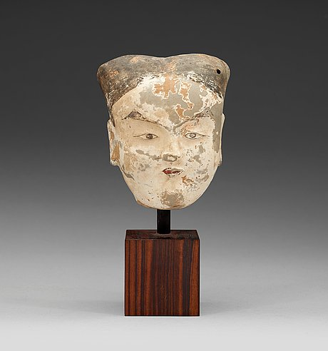 A painted pottery head of a female, han dynasty (206 bc - ad 220).