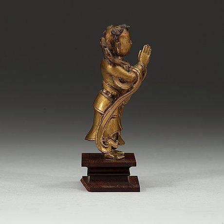 A gilt bronze figurine of a standing boy, ming dynasty, 17th century.