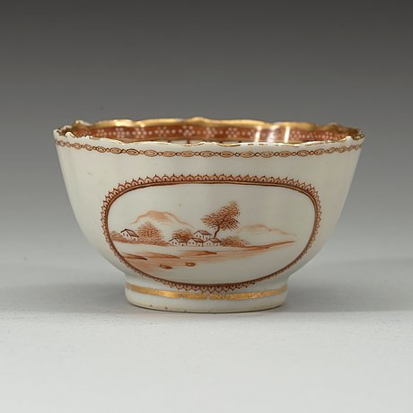 """A red and gold """"european subject"""" cup with saucer, qing dynasty, qianlong (1736-95)."""