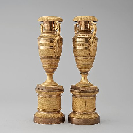 A pair of french empire early 19th century urns.