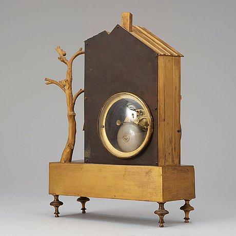 "A french ""style troubadour"" 19th century gilt bronze mantel clock."