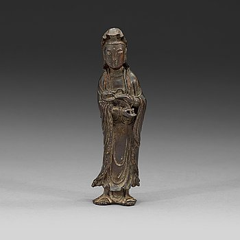 108. A bronze standing Guanyin holding a ruyi-scepter, Qing dynasty, 18th century.