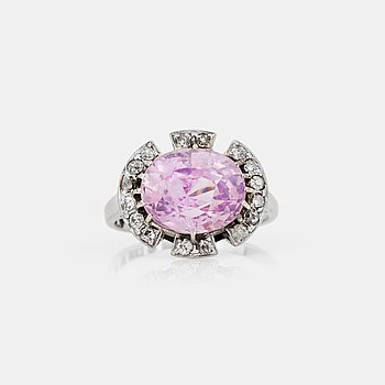 1109. A circa 5.80 ct oval-cut pink sapphire and old-cut diamond ring. Total carat weight of diamonds circa 0.50 ct.