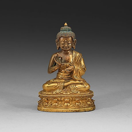 A partly gilt tibeto-chinese figure of maitreya buddha, 18th century.