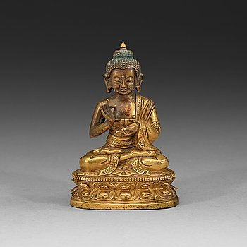 107. A partly gilt Tibeto-Chinese figure of Maitreya Buddha, 18th century.