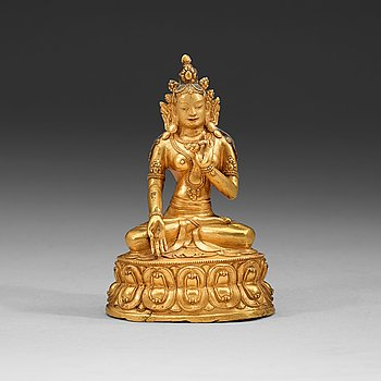 106. A partly gilt and painted Tibeto-Chinese bronze figure of White Tara, 18th Century.