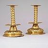 A pair of swedish baroque 18th century brass candlesticks.