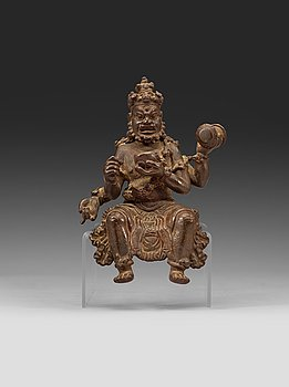 190. A seated bronze figurine. Ming dynasty.