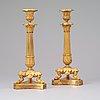 A pair of late empire 19th century gilt bronze candlesticks.