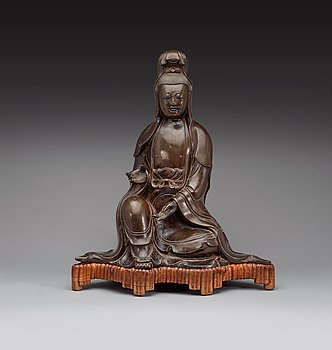 103. A large bronze figure of a seated Guanyin dressed in a flowing robe, Ming dynasty, 17th century.