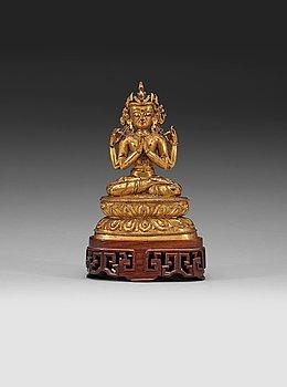 104. A gilt copper alloy figure of Sukhavati Avalokiteshvara seated on a high lotus base, Tibet, 15th/16th Century.