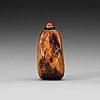 A soapstone snuff bottle with a carved landscape and a nine-character inscription, late qing dynasty (1644-1912).