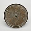 A bronze mirror marked 'feng xin fu zao' (made by feng xinfu), ming dynasty, 17th century.