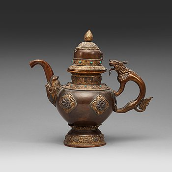 114. An copper alloy teapot with silver inlays, Tibet 19th Century.