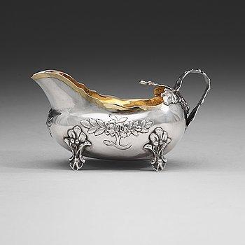 414. A Swedish 18th century parcel-gilt cream-jug, m arks of Anders Schotte, Uddevalla 1784.