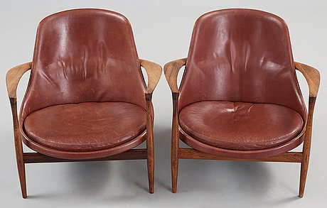 A pair of ib kofod larsen palisander and brown leather 'elisabeth' easy chairs, denmark 1950's-60's.