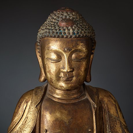 A large gilt bronze figure of buddha, ming dynasty (1368-1644).