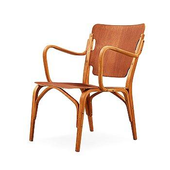 11. A Carl-Axel Acking beech and mahogany armchair, Svenska Möbelfabrikerna, Bodafors 1940's.