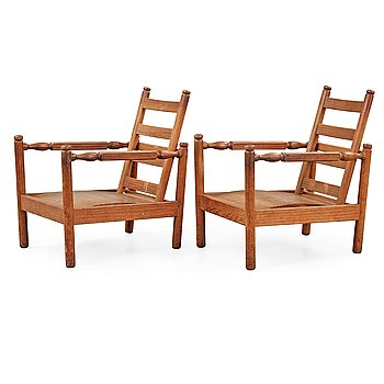 503. A pair of Axel Einar Hjorth stained pine 'Sandhamn' armchairs, Nordiska Kompaniet Sweden 1932.