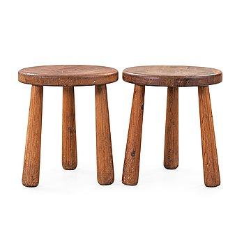 495. Axel Einar Hjorth, A pair of 'Utö' stained pine stools, Nordiska Kompaniet, NK, Sweden 1930's.