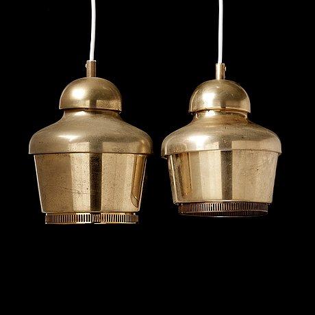 A pair of alvar aalto 'a330' brass pendant lamps, valaistustyö, finland.