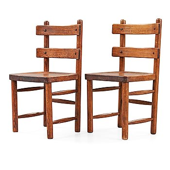 505. A pair of Axel Einar Hjorth stained pine 'Sandhamn' chairs.