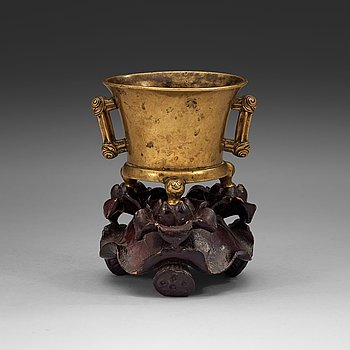13. A gilt copper alloy tripod censer, Qing dynasty, presumably 18th Century with Xuandes six character mark.