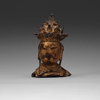 14. A bronze head of a guardian king, Ming dynasty (1368-1644).
