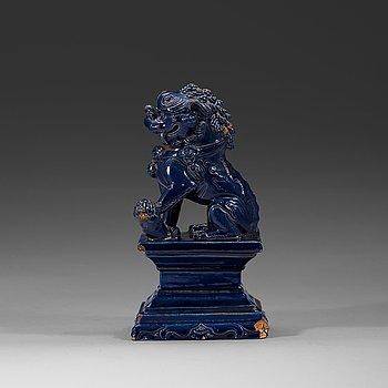 12. A seated blue glazed buddhist lion, Ming dynasty, 17th Century.