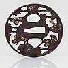 Tsuba, mässing, japan, meiji (1868-1912). signerad.