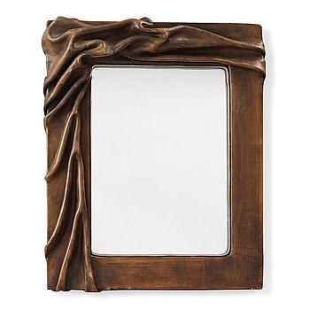 507. A 20th century leather framed mirror, unknown designer.