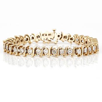 ARMBAND, med briljantslipade diamanter, totalt ca 3,50ct. 14K guld.