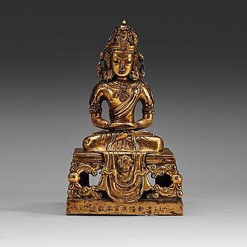 4. A gilt copper alloy figure of Amitayus, Qing dynasty, Qianlong (1736-95).