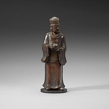 6. A bronze figure of a Mandarin official with a box, Qing dynasty, 19th Century.