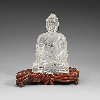 1. A large rock chrystal figure of a seated budda, Qing dynasty (1644-1912).
