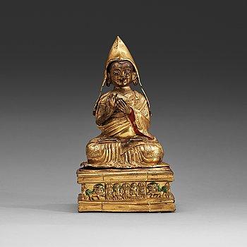16. A Mongolian repousse gilt copper figure of Tsong Kapa, 18th Century.