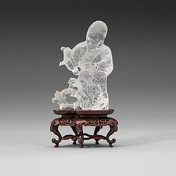 2. A carved rock crystal figure of Sholou, late Qing dynasty/early 20th Century.
