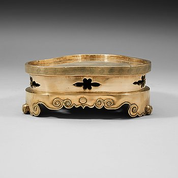 8. A polished copper alloy stand, Qing dynasty, 18/19th Century.