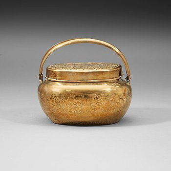 9. A Chinese engraved paktong hand warmer, Qing dynasty, 19th Century.