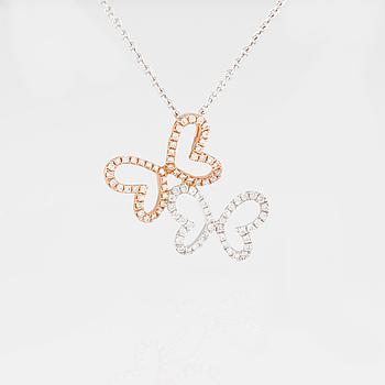 HÄNGE, 18K vit och roséguld med briljantslipade diamanter ca 0.15 ct. Vikt 3,1 gram.