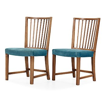 499. Axel Einar Hjorth, a pair of stained oak chairs, Stockholm 1940's.